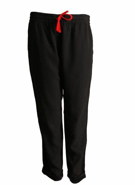 Celine Celine, black sportive trousers.