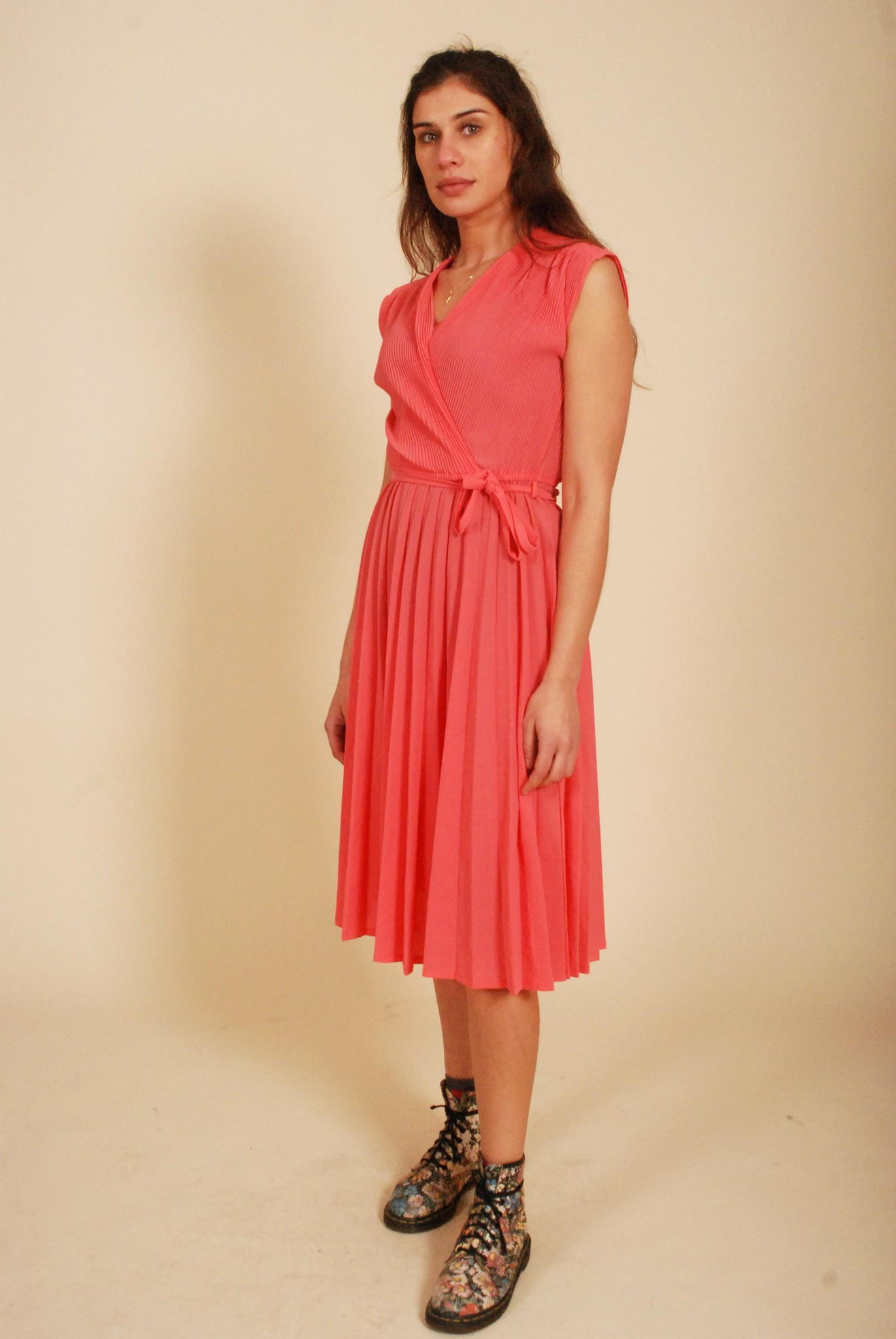 Pink pleated dress with wrapped front