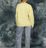 Cable knit pullover in yellow
