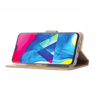 Bookcase Samsung Galaxy M10 hoesje - Goud