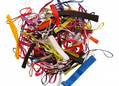Small bag of elastic bands in various colors and sizes