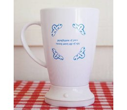 The Stir-it Cup, a self-movable mug, with a typical Dutch text buy?