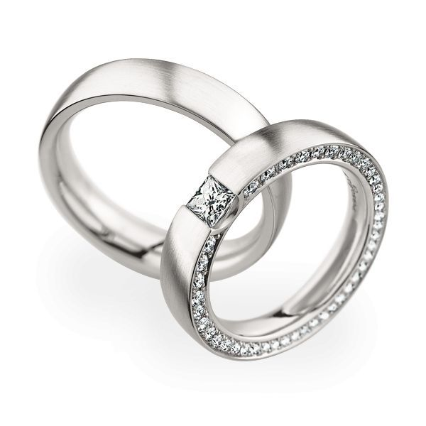 Trouwringen 950 Platina 42 briljanten / 1 Diamant Princess
