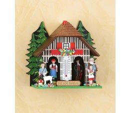 Trenkle Uhren Wetterhaus im Schwarzwald gefertigt aus Holz Die Figuren zeigen das Wetter an und so funktioniert ein Wetterhaus:Im Inneren des Wetterhäuschens befindet sich ein Strang aus Darmsaite,welche bei Luftfeuchtigkeitsveränderungen reagiert.Dabei verändert er