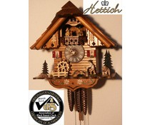 Hettich Uhren Original Black Forest cuckoo clock with 1 days music rack strike movement and moving wood chopper and mill wheel-dance figures 34cm high and 21cm wide
