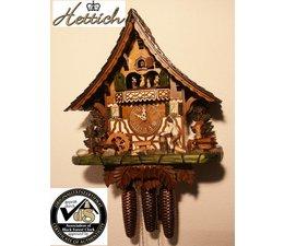 Hettich Uhren Oorspronkelijk in het Zwarte Woud handgemaakte koekoeksklok Zwarte Woud huisstijl 47cm hoog met bewegende houtversnipperaars dansfiguren en molenrad