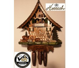 Hettich Uhren Oorspronkelijk in het Zwarte Woud handgemaakte koekoeksklok in Black Forest huisstijl van 47cm hoog met bewegende dansfiguren en molenrad