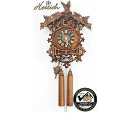 Hettich Uhren Orginal im Schwarzwald  handgefertigte Kuckucksuhr 45cm hoch und 35 cm breit  mit hangefertigter  Schnitzerei mit Holzgewichten