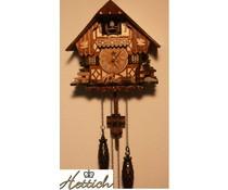 Hettich Uhren Kuckucksuhr 20cm  mit Quarzwerk  und automatischer Nachtabschaltung mit 12 verschiedene Melodien mit handgfertigten Holzfiguren