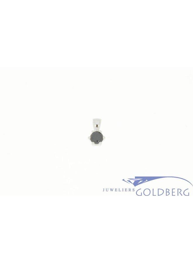 small silver pendant with a brilliant cut zirconia (white or black)