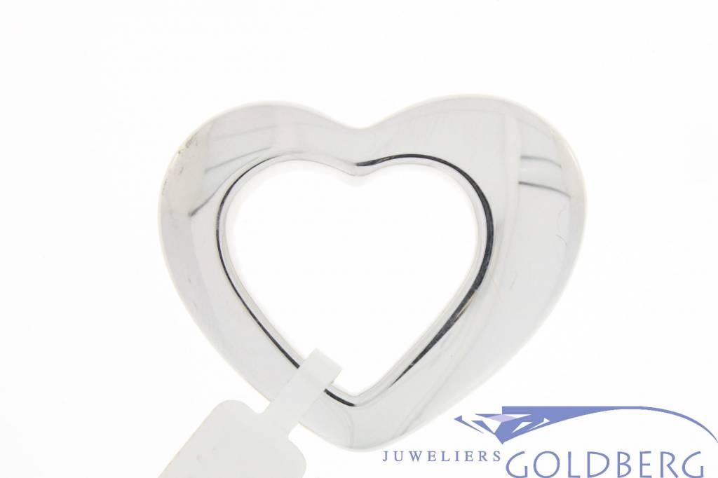 Large vintage 14 carat white gold asymmetric open heart-shaped pendant