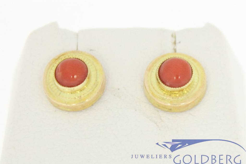 Vintage 14 carat gold circular ear studs with red coral