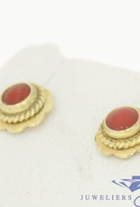 Vintage 14 carat gold flower shaped earstuds with darker red coral