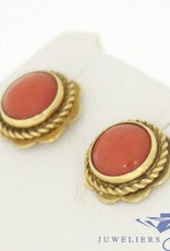 Vintage 14 carat gold earstuds with large red coral in flower ornament
