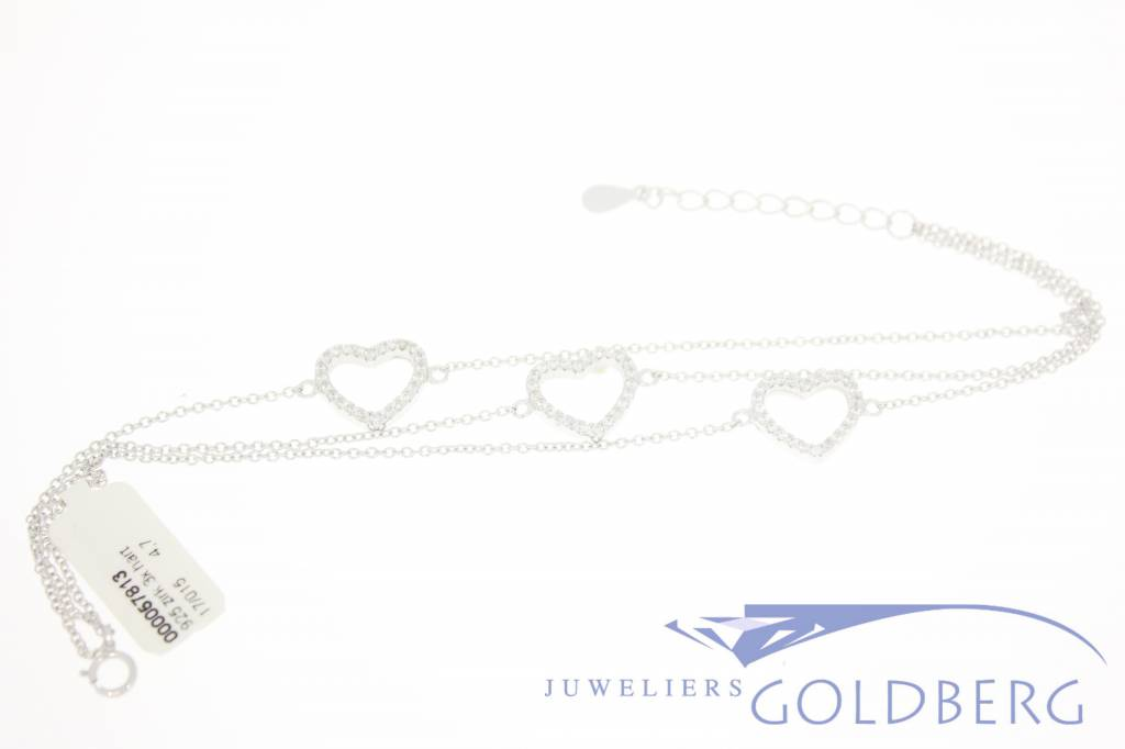 silver bracelet with three hearts