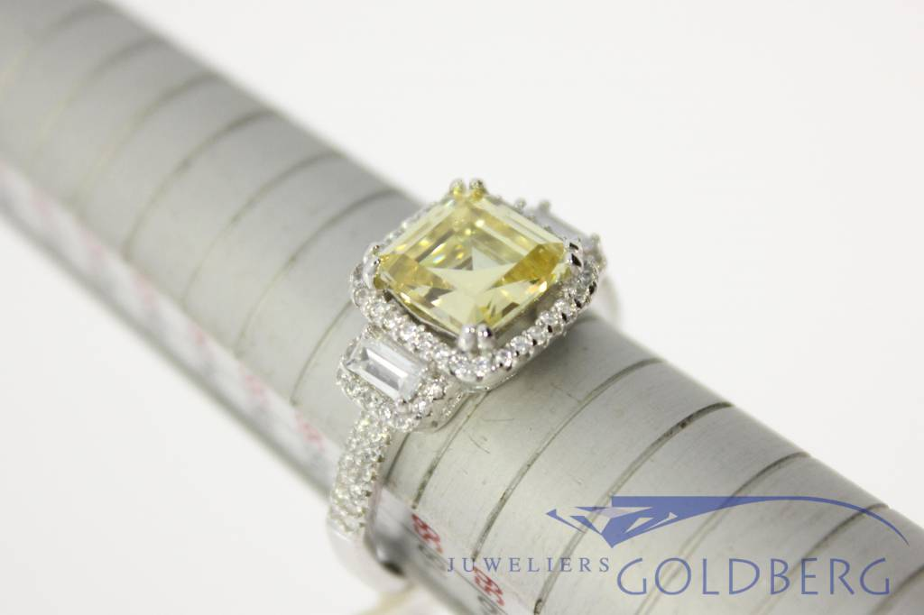 classic silver ring with various zirconia's