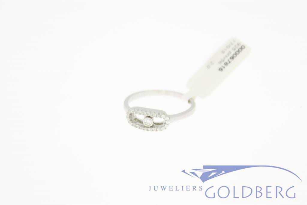 Small silver ring with movable zirconia