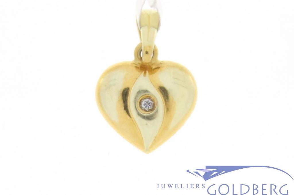Delicate vintage 14 carat gold edited heart pendant with zirconia