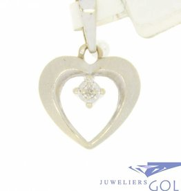 Vintage 14 carat white gold matted heart-shaped pendant with ca. 0.10ct brilliant cut diamond
