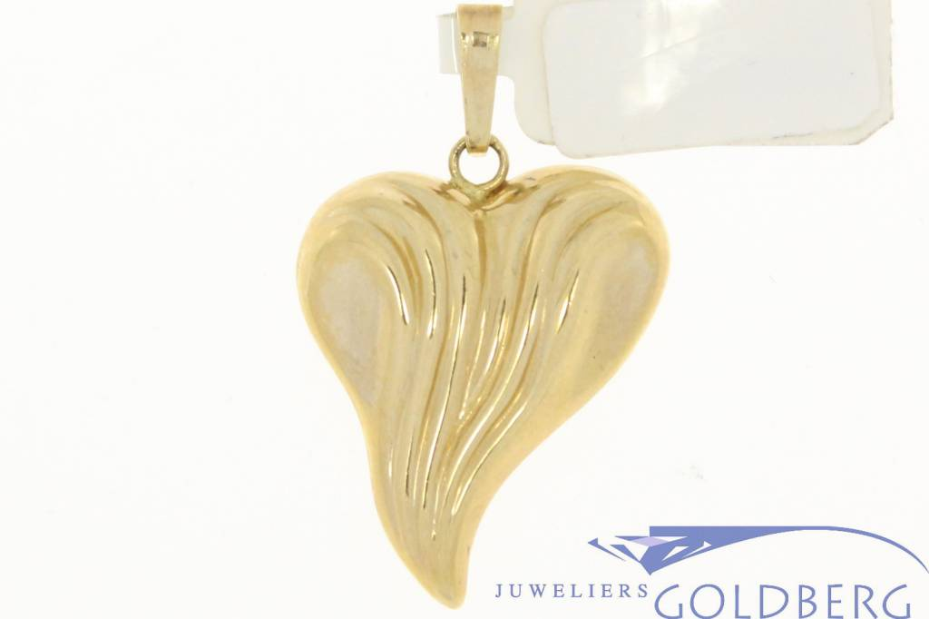 Vintage 14 carat gold whimsical heart-shaped pendant