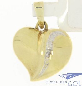 Vintage 14 carat gold heart pendant with row of diamonds