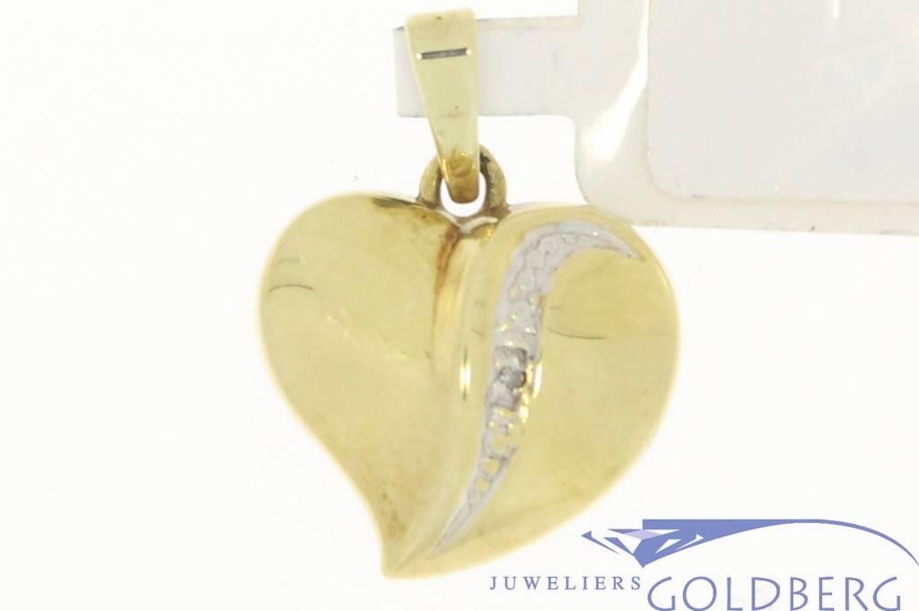 Vintage 14 carat gold heart pendant with row of diamonds
