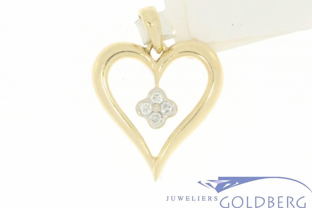 Vintage 14 carat gold open heart-shaped pendant with ca. 0.07ct brilliant cut diamond