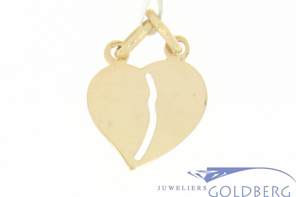 Vintage 14 carat gold breakheart pendant