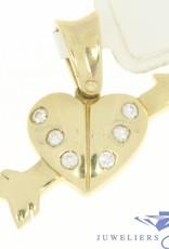 Vintage 14 carat gold heart shaped pendant pierced by an arrow and embedded with zirconia