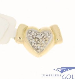 Vintage 14 carat gold heart pendant with ca. 0.054ct diamond