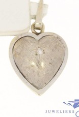 Vintage 14 carat white gold heart shaped pendant adorned with a tiny star and diamond