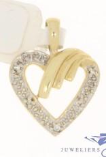 Vintage 14k gouden bewerkt open hartvormige hanger met ca. 0.025ct diamant