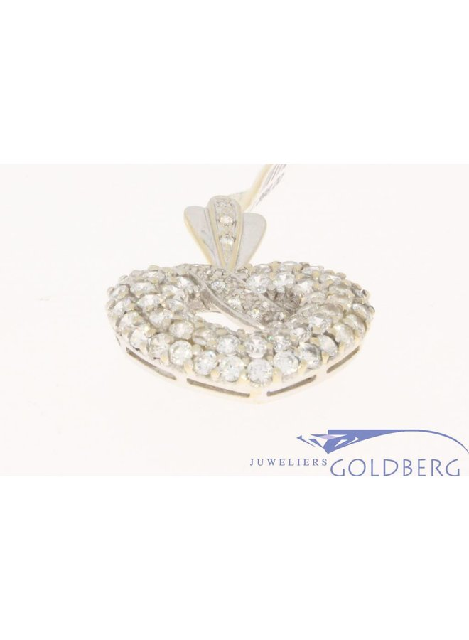 Vintage 14 carat white gold pendant embedded with zirconia
