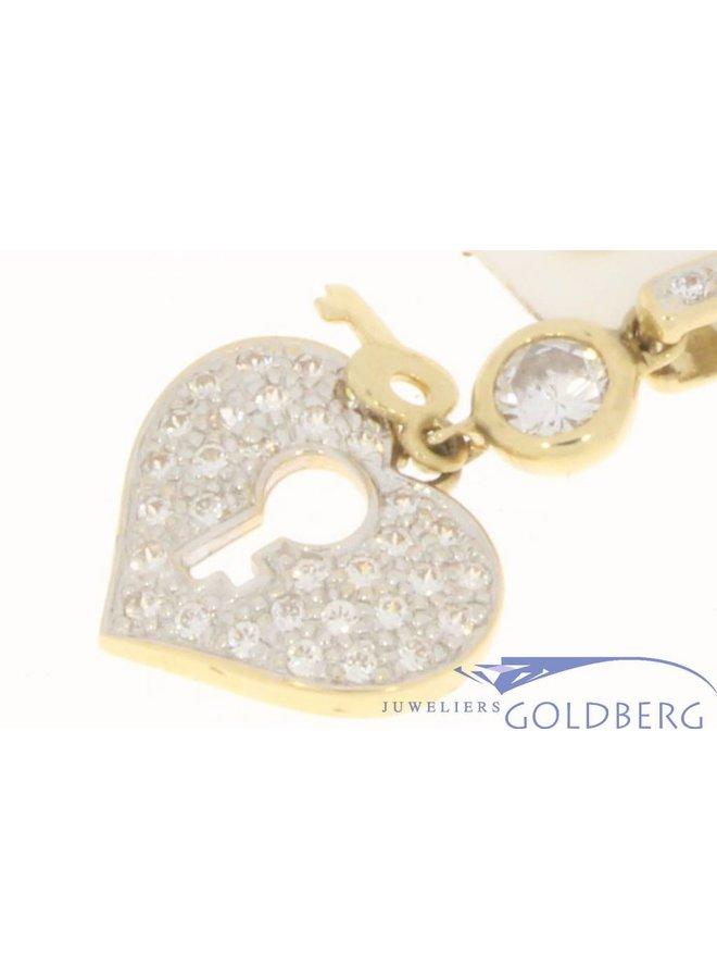 Vintage 14k gouden hartvormige hanger met sleuteltje en zirconia