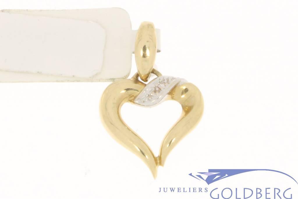 Vintage 14 carat bicolor gold open heart-shaped pendant with diamond