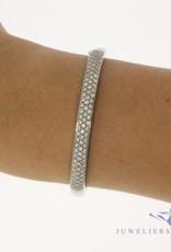 18 carat white gold bangle with approx. 1.00 carat brilliant cut diamond