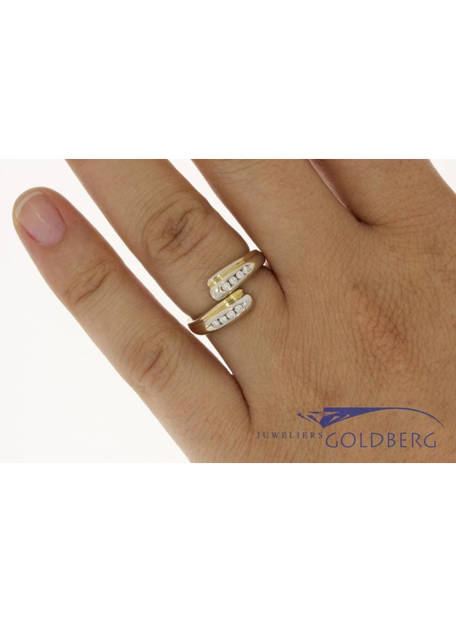 Elegant 18 carat bicolor gold vintage ring with approx. 0.15 carat brilliant cut diamond rail setting