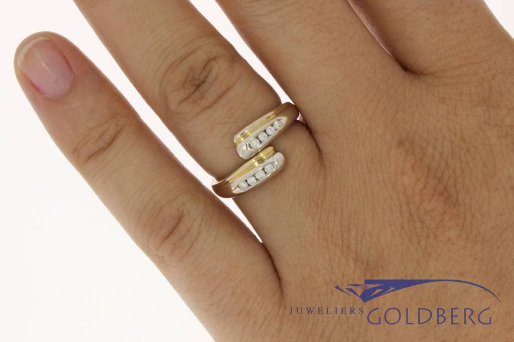 Vintage 18k bicolor ring met ca. 0.15c briljant in railzetting