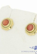Vintage 14 carat gold flower shaped earstuds with red coral
