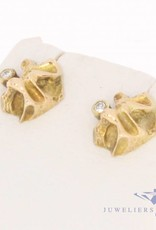 Vintage 14 carat gold edited earrings with ca. 0.06ct brilliant cut diamond