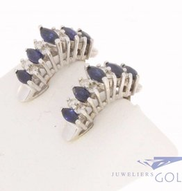 Vintage 18 carat white gold ear clips with ca. 0.24ct brilliant cut diamond and blue sapphire