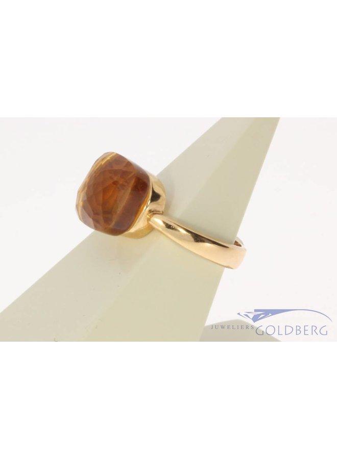 18 carat gold ring with facet cut orange stone