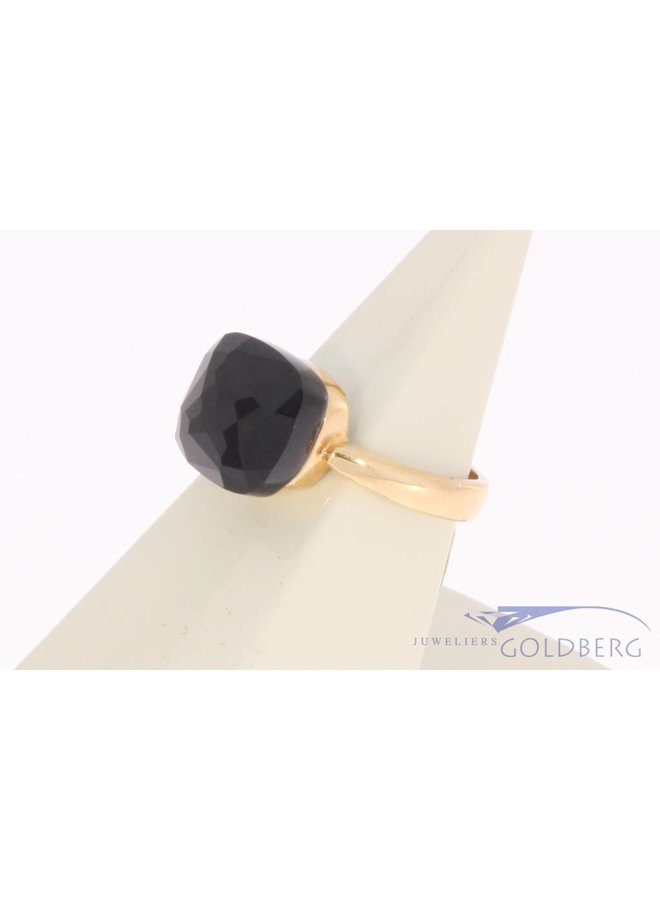 18 carat gold ring with facet cut black stone