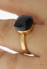 18 carat rose gold ring with facet cut black stone