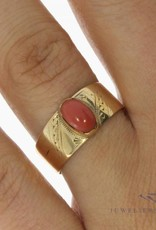 Vintage 14 carat gold adorned ring with red coral