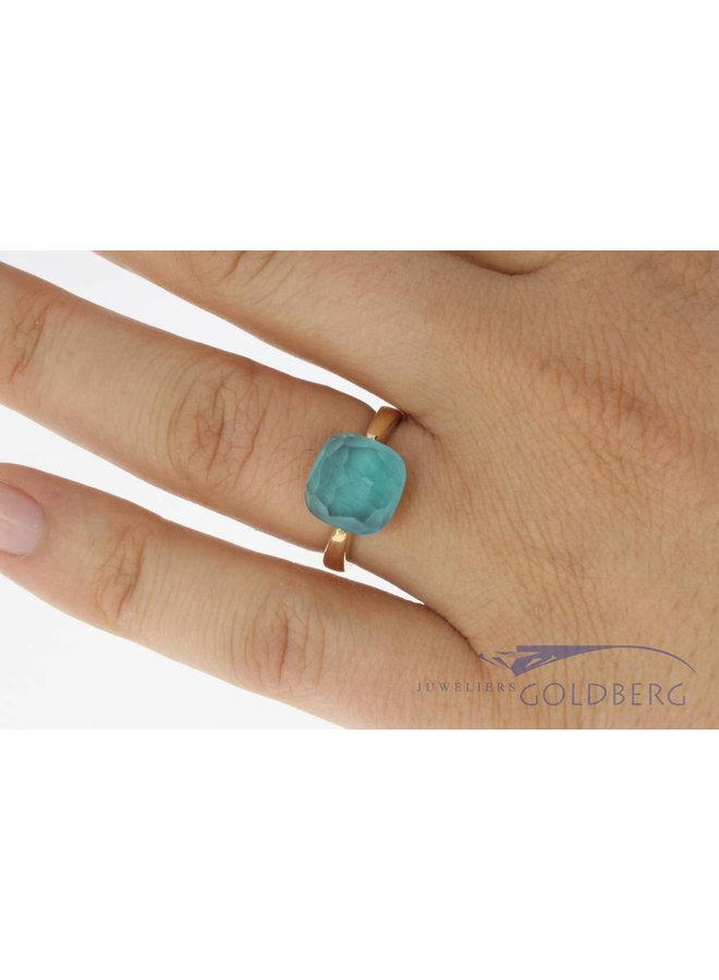 18 carat gold ring with facet cut blue stone