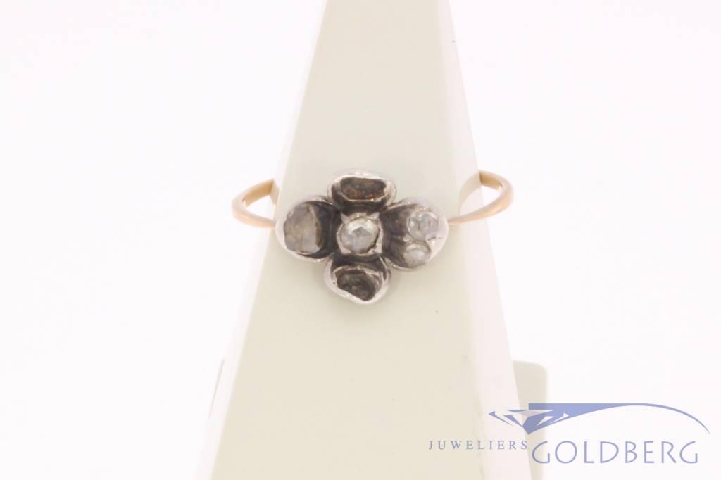 Antieke 14k gouden en zilveren bloemvormige ring met diamant