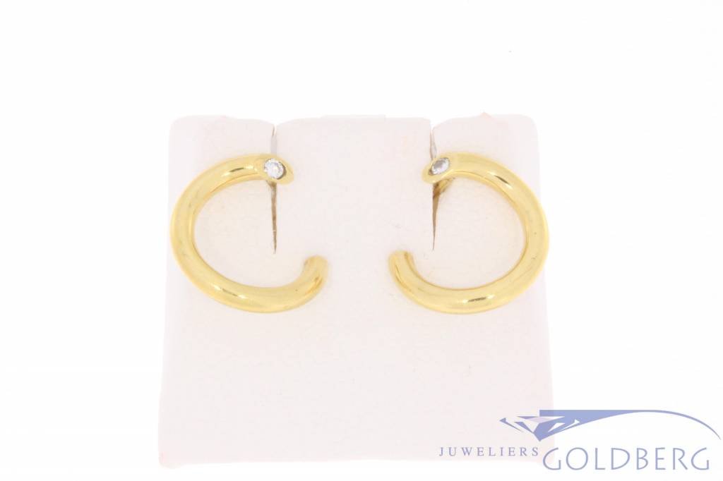 Vintage 18 carat gold twisted earrings with 0.09ct brilliant cut diamond