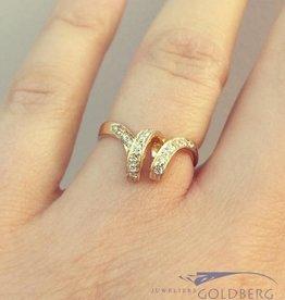 Vintage 14k gouden gekrulde ring met ca. 0.17ct briljant