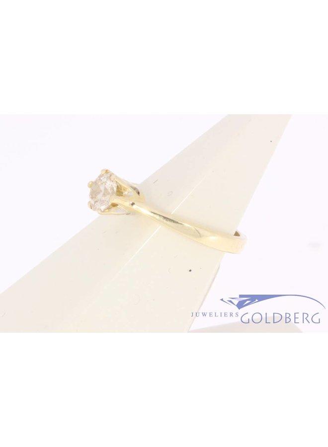 14k gouden solitaire ring met ca. 0.56ct passion fire diamant